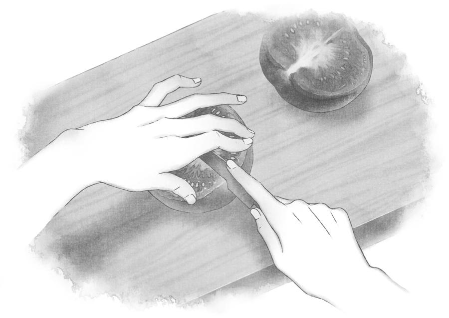 料理する手